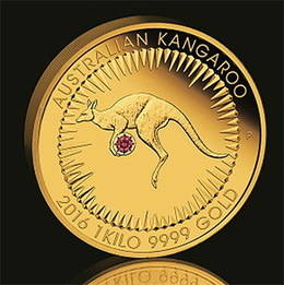 Una moneda de oro de 1 kilo con diamante rojo incrustado