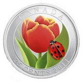 El tulipán y la mariquita, moneda canadiense de plata con cristal veneciano
