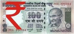 Billetes de 100 y 1.000 rupias con el nuevo símbolo